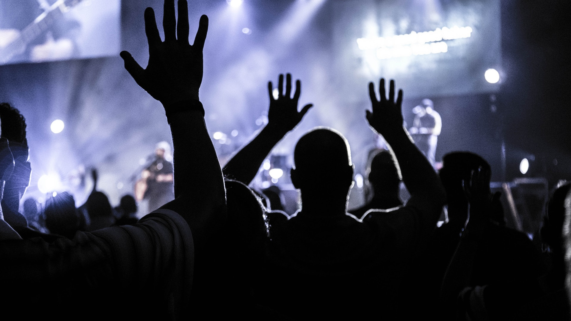 audience hands in the air in worship